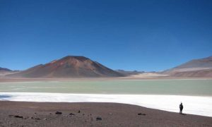 The Altiplano-Puna plateau in the central Andes features vast plains punctuated by spectacular volcanoes, such as the Lazufre volcanic complex in Chile seen here. Credit: Noah Finnegan