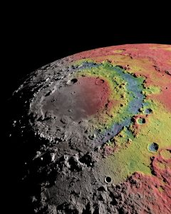 The Moon's Orientale basin is surrounded by distinct right structures. The image shows the basin's gravitational signature (red indicates excess mass, blue indicates mass deficits), which scientists used to reconstruct the formation of the basin and its rings. Ernest Wright, NASA/GSFC Scientific Visualization Studio.)