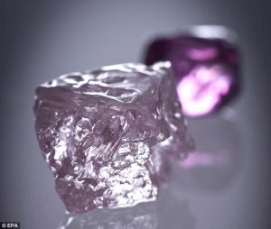 The Argyle Pink Jubilee diamond with a smaller Argyle pink diamond in the background