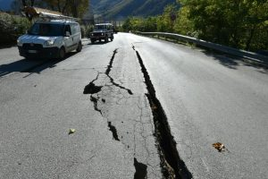 Cracks on the road outside the centre of Norcia, central Italy pictured a day after a 6.5-magnitude earthquake struck on October 30, 2016 . Credit: AFP/Alberto Pizzoli