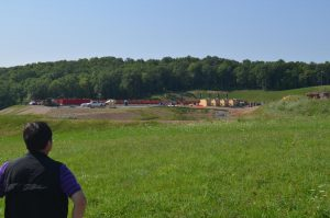 A study done in northeastern Pennsylvania suggests that drinking water near hydraulic fracturing sites is undergoing chemical changes. Lead author Beizhan Yan checks out a site on a back road. Credit: Kevin Krajick/Lamont-Doherty Earth Observatory