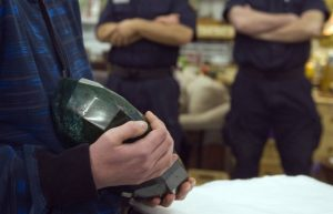 "A visitor holds the world's largest emerald as security guards stand nearby at the Western Star Auction House in Kelowna, British Columbia January 26, 2012. The 57,500 carat emerald, named ""Teodora"", which weighs 11.5 kg (25.35 lb) was mined in Brazil and cut in India. The stone will be publicly auctioned this weekend. REUTERS/Andy ClarkREUTERS/Andy Clark"