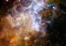 Some of the coldest and darkest dust in space shines brightly in this infrared image from the Herschel Observatory.