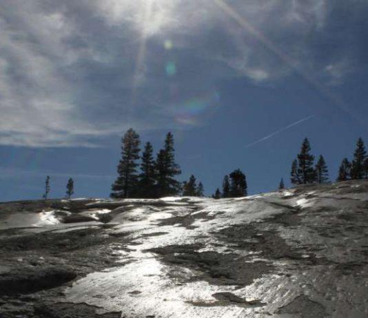 Glacial polish reflects sunlight at Pothole Dome in Yosemite National Park, California.