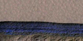 A cross-section of underground ice is exposed at the steep slope that appears bright blue in this enhanced-color view from the HiRISE camera on NASA's Mars Reconnaissance Orbiter.
