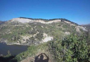 The Stanton Landslide (center middle distance) is over 800 meters across and has left an obvious scar in the hillside above the deposit.