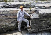This is professor Rais Latypov in front of an example of the stratified chromite layers.