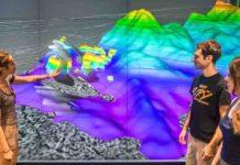 The Galicia group -- from left, Rice graduate student Nur Schuba, alumnus Ara Alexanian and graduate research assistant Mari Tesi Sanjurjo -- discuss the northwest portion of the 3-D seismic volume at Rice's Visualization Lab.