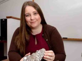 Jessica Irving sits with two meteorites Princeton seismologist Jessica Irving