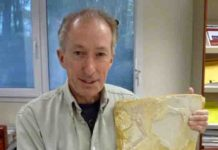 Dr. John Nudds with Archaeopteryx fossil specimen at the European Synchrotron in Grenoble.