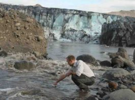Dr Peter Wynn, Lancaster University, taking a sample in Iceland. Credit: Dr Hugh Tuffen