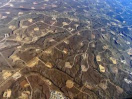 This is an aerial view of hydraulic fracturing operations across the Jonah field, a large natural gas field in Wyoming.