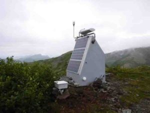 Transportable Array station P19K is one of the closest stations to the Iniskin earthquake origin. Solar panels power the station, and the seismometer is buried in a specially drilled borehole to insulate it from surface noise. Photo taken in 2017 during a service site visit by Incorporated Research Institutions for Seismology (IRIS). IRIS manages the Transportable Array station installation and maintenance. Credit: Doug Bloomquist, IRIS