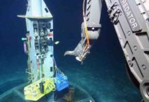 Scientists use the deep-diving robot Jason to collect water samples from oceanic crust at a subseafloor observatory off the coast of Washington. A recent study found that a group of unusual microbes living below the seafloor provides clues to the evolution of life on Earth, and potentially other planets. Credit: Woods Hole Oceanographic Institution, courtesy of University of California, Santa Cruz, US National Science Foundation, ROV Jason dive J2-711, 2013, AT26-03 cruise chief scientist Andrew Fisher