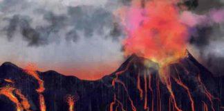 A volcano erupts