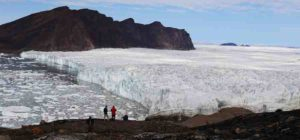 The calving front of Bowdoin Glacier in northwestern Greenland, where icebergs are discharged and ice under the water melts.