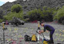 U of T's Jeremy Rimando sets up Differential Global Positioning System (DGPS) survey equipment to measure the amount of displacement on the Las Chacras Fault in San Juan, Argentina.