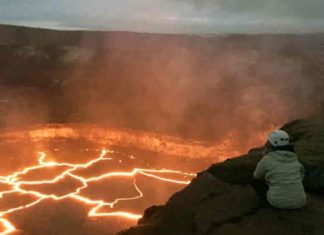 Brittany Erickson, an assistant professor in the Department of Computer and Information Science who studies geophysics and is a colleague of UO's Leif Karlstrom, peers into the Halema'uma'u lava lake on Hawai'i's Kiīlauea volcano. Credit: University of Oregon