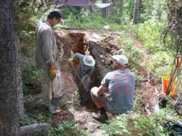 The excavation of trench B at the Leigh Lake site. Shown in the photo (from left to right) are Glenn Thackray, Cooper Brossy, and Darren Zellman. Credit: Mark Zellman
