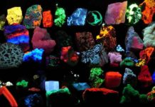 Collection of various fluorescent minerals under ultraviolet UV-A, UV-B and UV-C light. Chemicals in the rocks absorb the ultraviolet light and emit visible light of various colors, a process called fluorescence. Credit: Hannes Grobe/AWI