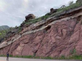 "Francis Macdonald walks along a road near Manitou Springs, Colorado, where an exposed outcrop shows a feature known as the ""Great Unconformity."""