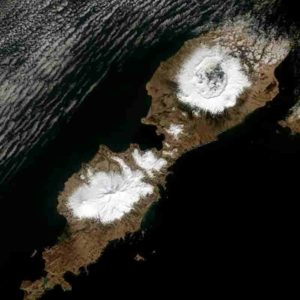 Alaska's Umnak Island in the Aleutians showing the huge, 10-km wide caldera (upper right) largely created by the 43 BCE Okmok II eruption at the dawn of the Roman Empire. Landsat-8 Operational Land Imager image from May 3, 2014