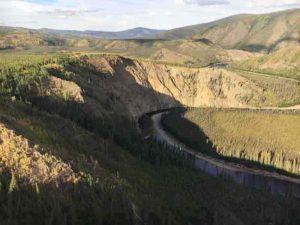 Broad surfaces called terraces preserve ancient river floodplains and landscape history up to hundreds of meters above the Fortymile River, a tributary of the Yukon River, in eastern Alaska. Researchers from the USGS, the University of Vermont, Purdue University and Utah State University publish definitive support that increases in sediment deposited to oceans from river erosion coincide with dramatic changes in glacial cycles. Credit: USGS
