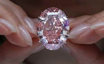 The Pink Star diamond, which fetched the highest price ever for a jewel offered at auction, is displayed at Sotheby's in Hong Kong on March 29. Credit: Vincent Yu/AP