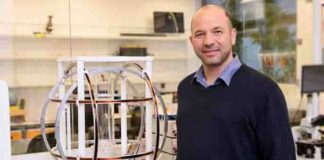 Next to Prof. Oded Aharonson is the tri-axial Helmholtz Coil used to generate the magnetic field during the growing of the ice samples