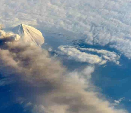 A plume of ash and dust rises from Pavlof Volcano on the Alaskan Peninsula in 2013. Credit: NASA