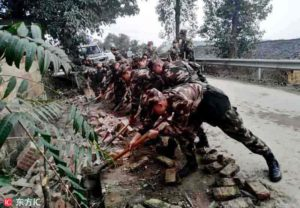 Soldiers remove bricks from the road after earthquake in Rongxian county on 25 February 2019. | Credit: IC
