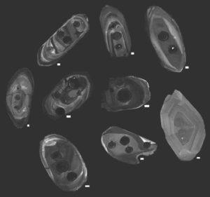 Zircons studied by the research team, photographed using cathodoluminescence, a technique that allowed the team to visualize the interiors of the crystals using a specialized scanning electron microscope. Dark circles on the zircons are the cavities left by the laser that was used to analyze the age and chemistry of the zircons.Scientists led by Michael Ackerson, a research geologist at the Smithsonian's National Museum of Natural History, provide new evidence that modern plate tectonics, a defining feature of Earth and its unique ability to support life, emerged roughly 3.6 billion years ago. The study, published May 14 in the journal Geochemical Perspective Letters, uses zircons, the oldest minerals ever found on Earth, to peer back into the planet's ancient past.The team tested more than 3,500 zircons, each just a couple of human hairs wide, by blasting them with a laser and then measuring their chemical composition with a mass spectrometer. These tests revealed the age and underlying chemistry of each zircon. Of the thousands tested, about 200 were fit for study due to the ravages of the billions of years these minerals endured since their creation. Credit: Michael Ackerson, Smithsonian.